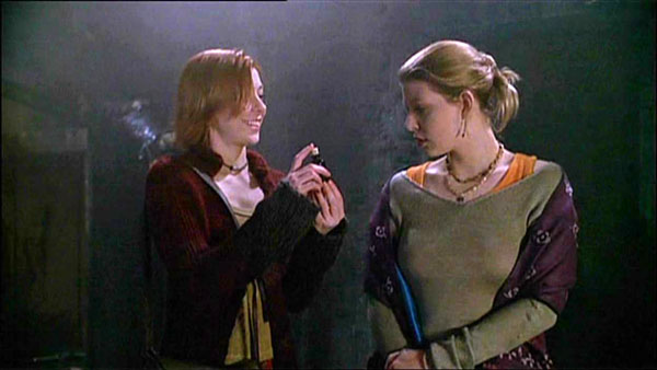Willow shows off her newly-developed Light spell to a dubious Tara