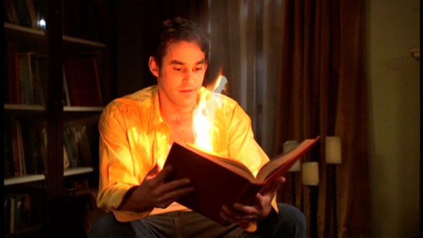 Xander casts the 'Libris Incendis' spell